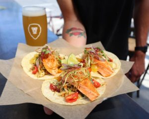 Aslan salmon tacos for eat local month with an organic beer in Bellingham, WA