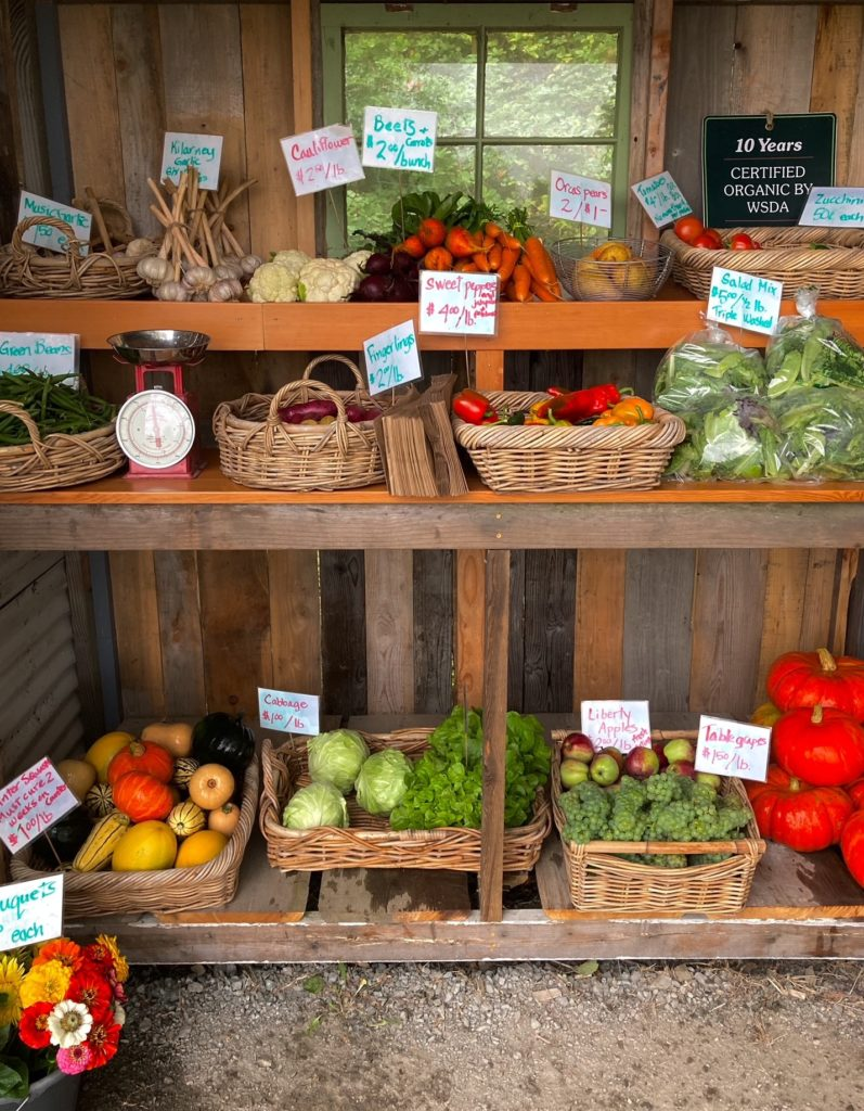fresh produce in baskets for sale at Colony Creek's farm stand